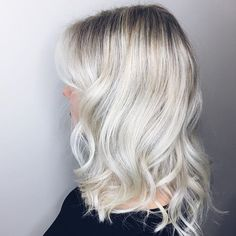 Icy blonde platinum hair with ash colour melt on roots. Rooty blonde. White blonde with roots. Aveda colour with olaplex.