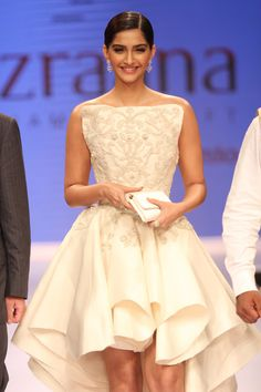 Sonam Kapoor looked chic and glamorous in a white ruffle dress at the Indian International Jewellery Week 2014.