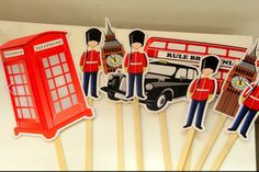 London Theme Birthday Party England Queen Union Jack Flag cupcakes cakes cake cake pops decorations flowers theme bus car big ben telephone booth red blue white props photo booth props guards