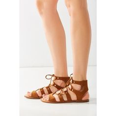 Dolce Vita Jasmyn Gladiator Sandal ($90) ❤ liked on Polyvore featuring shoes, sandals, brown, brown strappy sandals, strappy flat sandals, studded gladiator sandals, lace up flat sandals and greek sandals