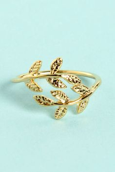 Check it out from Lulus.com! Leave it to the Leaf Me Be Gold Knuckle Ring to perk up your style in a flash! A thin golden band opens into two pretty sprigs of leaves that rest stop your first knuckle for a fresh addition to your fashion. Ring comes in size 4, but will adjust to fit. Man made materials. Imported.