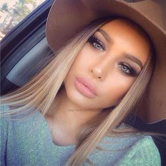 Smokey eyes and light pink lips creates a perfect balance for an edgy daytime look!