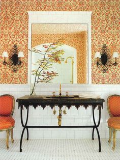 Stunning bathroom idea - so elegant. Orange and gold accents work well with blank sink and counter.