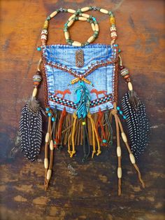custom make DENIM medicine bag tribal american INDIAN medicine bag with FEATHER charm turquoise suede leather beaded necklace. $94.00, via Etsy.