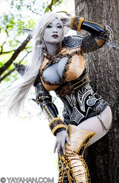 Female drow in skimpy outfit posing against a tree in the daylight.  Cause drow love the bright lights.  ---------------------------------------- 77 pics of cosplay sensation Yaya Han as Lineage 2 Dark Elf