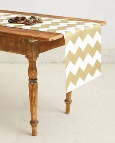 This table runner can be used at any time for any occasion! Get it here: http://www.bhg.com/shop/anthropologie-gilt-chevron-paper-table-runner-p527a45ffe4b0bbd24e06e5b4.html