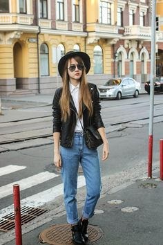 Something as simple as opting for a black leather biker jacket and blue boyfriend jeans can potentially set you apart from the crowd. Elevate your getup with black cutout leather booties.  Shop this look for $114:  http://lookastic.com/women/looks/hat-shortsleeve-button-down-shirt-boyfriend-jeans-ankle-boots-biker-jacket-crossbody-bag/4386  — Black Wool Hat  — White Short Sleeve Button Down Shirt  — Blue Boyfriend Jeans  — Black Cutout Leather Ankle Boots  — Black Leather Biker Jacket  — ...