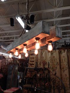 Distressed wood beams chandelier with Edison style bulbs