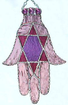 Jewish Hamsa Design Stained Glass Suncatcher - Handcrafted Stained Glass Sun Catcher - Mauve & Purple Glass Stained g;ass suncatchers, Glass art, Suncatchers, Stained glass, Art glass, Glass sun catcher, Stained glass panel, Glass suncatchers, Stained glass suncatcher -   by StainedGlassDelight on Etsy