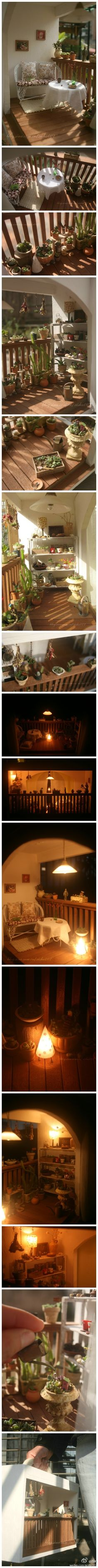 Miniature deck/porch with tiny miniature garden and tiny plants, lights, watering can--just wonderful!
