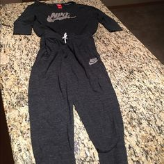 Nike Sweatsuit Soft comfy Nike workout pants and top in a rich speckled dark gray.  Worn a few times, but pants just weren't long enough (I am tall). Pants have a gathered ankle fit.  Really cute when worn at the ankle where it is supposed to be Nike Other