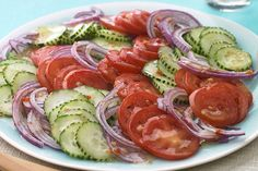 Cucumbers, tomatoes and red onions: Summer's brightest trio is smartly dressed and ready to go in this potluck-perfect Cucumber-Tomato salad.