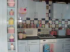 Love this side cabinet (with the cupcakes on it.  would work well in that useless space between the fridge and cabinet