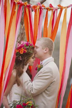 Make a ribbon drape as a photo backdrop or even a curtain to jazz up a doorway?  #wedding #brights #backdrop #curtain #paper