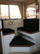 Custom boat cabin bench cushions made with Sunbrella Black fabric