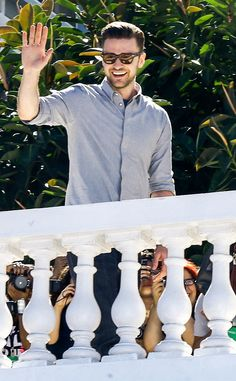 Justin Timberlake, in black wayfarer-inspired shades with translucent yellow lenses, was all smiles as he waved to fans in Brazil!
