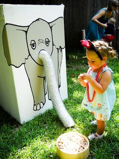 """Feed the Elephant ( painted this on a washing machine box and used a dryer vent for the trunk.) The kids would place peanuts in the trunk to """"feed the elephant"""" and raise the trunk until the peanuts dropped inside. Great idea for a circus party. Circus Party Games, Circus Carnival Party, Kids Carnival, Carnival Birthday Parties, Circus Game, Carnival Ideas, Preschool Circus Theme, Halloween Carnival Games, Circus Food"""