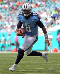 Titans vs. Dolphins:  30-17, Titans  -  October 9, 2017  -     Miami Dolphins fail to stop Tennessee Titians quaretrback Marcus Mariota as he runs for a first quarter touchdown at the Hard Rock Stadium in Miami Gardens, Florida, October 9, 2016.