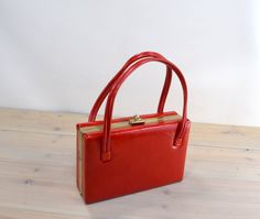A personal favorite from my Etsy shop https://www.etsy.com/listing/466383251/vintage-red-travel-tote-or-small-purse