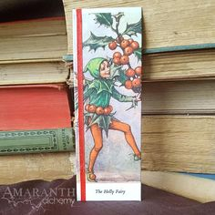 Flower Fairies Holly Book Page and Ribbon Bookmark Ribbon Bookmarks, Flower Fairies, Special Person, Red Ribbon, Book Pages, Alchemy, New Books, Charity, Fairy