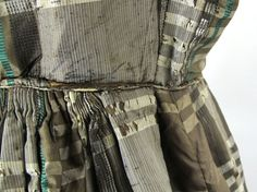 1862-67 plaid silk dress. Skirt pleats switch to rather bulky gauging at the center back. Ebay seller Estateauctionsinc.
