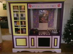 Play kitchen made from an entertainment center