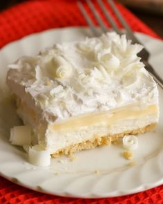This White Chocolate Lasagna Is An Amazing Dessert With So Many Layers Of Goodness. With A Golden Oreo Crust, Cream Cheese, Layer, White Chocolate Pudding, Whipped Cream And White Chocolate Curls On Top - It Is Sure To Be A Hit At Any Function.