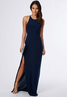 Make dark blue slit maxi dress your outfit choice for a trendy and easy going look. For footwear go down the classic route with silver leather heeled sandals. Shop this look on Lookastic: https://lookastic.com/women/looks/navy-maxi-dress-silver-heeled-sandals-silver-clutch-silver-bracelet/10851 — Navy Slit Maxi Dress — Silver Bracelet — Silver Leather Clutch — Silver Leather Heeled Sandals