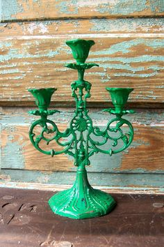 Upcycled Candelabra Grass Green Candle Holder by VintageInColour --It can be any color but I am looking for one that is shaped like this-this was sold on Etsy. It comes in brass, I believe, and the person who sold it painted it green. Candle Lamp, Candleholders, Candlesticks, Green Candles, Green Candle Holders, Diy Chandelier, Chandeliers, Spray Paint Cans, Different Shades Of Green