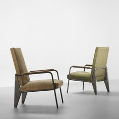 JEAN PROUVÉ    pair of lounge chairs    Ateliers Jean Prouvé  France, 1939  steel, oak, upholstery over horsehair and wood  25 w x 31.5 d x 38 h inches  Sold with alternate seat and back cushions (not shown).    PROVENANCE: Galerie de Beyrie, New York | Private collection    more    Estimate: $70,000–90,000  Result: $104,500