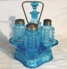 """EAPG Antique BLUE PATTERN GLASS CASTOR SET: BOTTLES & STAND  Stand measures 8 3/4"""" high x 5 3/4"""" across sides & Bottles are 4 5/8"""" to 6 3/4"""" tall. Few Small Chips on the Bottom of the Shell Pattern Corners.  SOLD $95.00"""