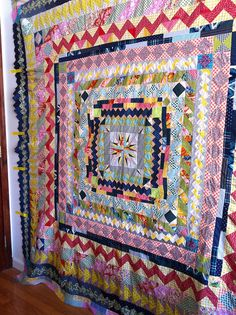 Medallion Quilt by carriestrine, via Flickr Love the color scheme- navy-berry-olive green.
