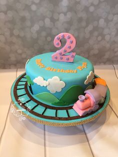 Special lil train cake for a 2 year old baby girl birthday by Lil Mrs Cake Heart. Www.facebook.com/lilmrscakeheart