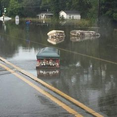 Caskets in Baton Rouge Louisiana, exhumed by floods & floating in the road. - Imgur
