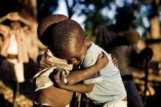 This picture breaks my heart. To help - a list and ranking of charities helping Africa is attached.