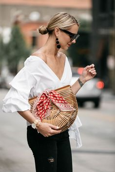 Blonde Woman Wearing Club Monaco Ruffle Sleeve Wrap Top Cult Gaia Ark Bag Red Bandana Black Ripped Skinny Jeans Street Style Outfit