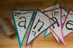 From Social Graces:  DIY Music sheet name pennant banner