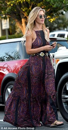 Pretty in purple: The stylish star showed off her trim figure in the summery dress, which she had cinched in with a leather belt with gold embellishments