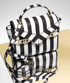 fe39e764 The Uptown Mini Striped Satchel is a darling and petite designer bag  crafted with slightly pebbled