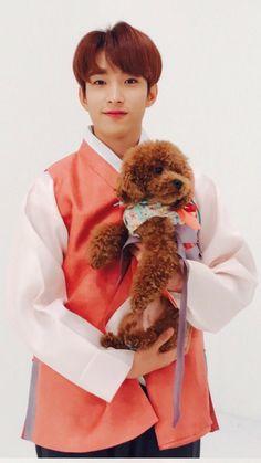 Seokmin with Coco aka a puppy holding a puppy