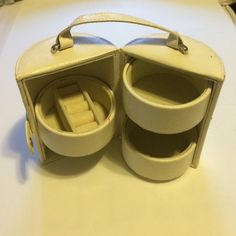 Cylinder leather jewelry case Great for travel! Space for bracelets, rings and necklaces. Leather outside and padded vision material inside. Button snaps shit. Handle for easy transportation. Rarely used. Bags Cosmetic Bags & Cases