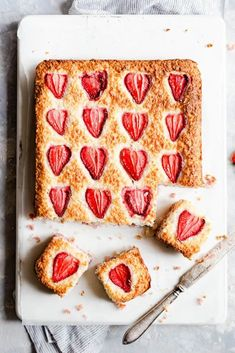 Make this easy and delicious treat of strawberry coconut ice squares from Anna Banana Co! Soft, sweet and chewy squares made with layers of creamy coconut and sweet and juicy berries. Easy recipe, perfect for sharing! #coconutice #dessert