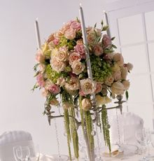 Enchantment Centerpiece  A silver candelabra is adorned with a soft mix of pastel floral.