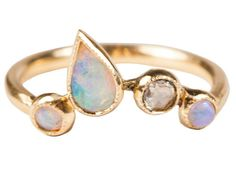 A rounded opal and diamond number.