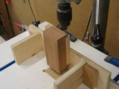 I posted these items mainly to show the jig I had made to locate and drill the pin hole for a palm box lid. The jig is made to be clamped to my drill press table's fence. There are one hole on each side of the jig located from the outside . Drill Press Table, Box With Lid, Tea Light Holder, Knife Block, Wooden Boxes, Tea Lights, Palm, Projects, Wood Boxes