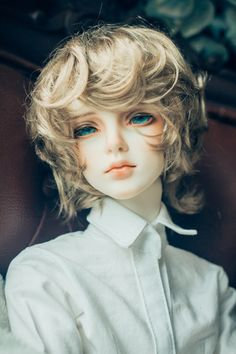 Bjd, with beautiful ocean eyes. The hair is perfect color too, perfect merman...