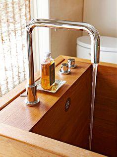 A custom teak tub in a nature inspired bathroom. Photo courtesy of Better Homes & Gardens.