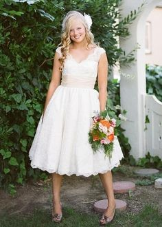 Might make my shoulders look wider? Lace tea length wedding dress :)