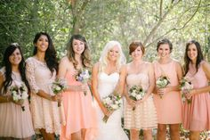 We love the look of these peach bridesmaid dresses. The mismatched dresses are monochromatic, but maintain the peach hue.