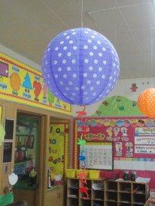 hang different colored lanterns above each table group and hang barrel of monkey monkeys for table points